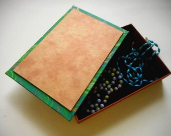 """Decorative hand-made box for your jewelry or heirlooms - Rich leather with enameled inset -  """"Wheel"""". Jewelry box. Storage. Knick-knacks"""