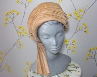 1960s 70s Vintage Turban Light Camel Tan Turban Style Hat Ladies Pleated Turban Hat with Side Tassle Trikki by Edna Wallace