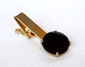 Vintage tie clip...vintage tie bar...black glass...worn gold tone.
