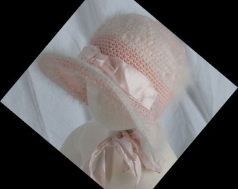 1940s, pink and angora crocheted baby bonnet with wide wired brim.