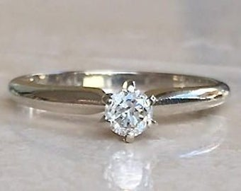 LOVELY Classic 14k Diamond Solitaire Engagement Ring .25 carats Sized between a 6.25 - 6.5 Weighing 2.3 grams Stackable