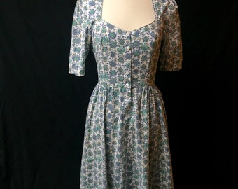 Vintage 1950's inspired blue and green flowered cotton day dress. Sweet heart neckline. 3/4 circle skirt. Mint condition. No tag