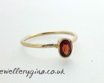 Hepburn in red, garnet ring, gold ring