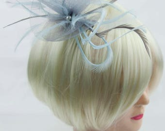 Silver grey fascinator with accent colour of pale powder blue. On a clip, comb or Alice band