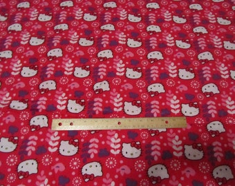 30 Inches Hot Pink Flowered Hello Kitty Faces Flannel Fabric