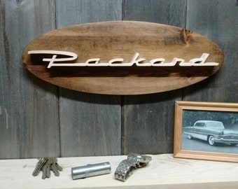 1956 Packard Emblem Oval Wall Plaque-Unique scroll saw automotive art created from wood for your garage, shop or man cave.