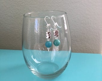 round turquoise and flat silver bead earrings on sterling silver leverback ear wires
