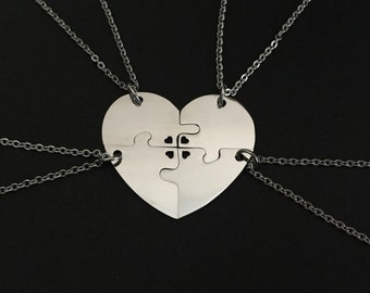 4 Stainless Steel Heart Puzzle Necklaces. 4 Piece Puzzle Necklaces. Personalized Puzzle Necklaces. Matching Puzzle Necklaces. Jigsaw Puzzles
