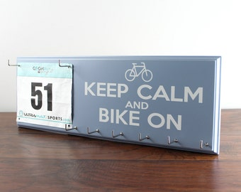 Cycling Medal Holder and Race Bib Hanger - Keep Calm and Bike On Display for race bibs and medals.