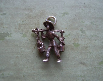 A Vintage Silver Charm - Water Carrier.