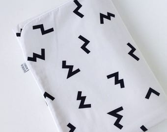 White baby blanket with black print