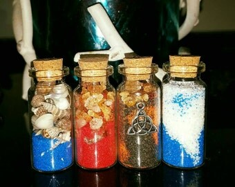 Four elements set of 4. including triquetra charm, moon charged botanical crystals.bonus rose quartz.fire air water earth. Spiritual bottles