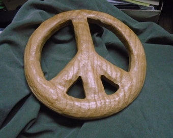 Carved wood peace sign wall ornament. Reclaimed wood peace symbol wall decor.