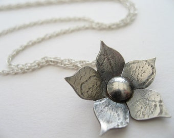 Flower pendant necklace in sterling silver with lace texture