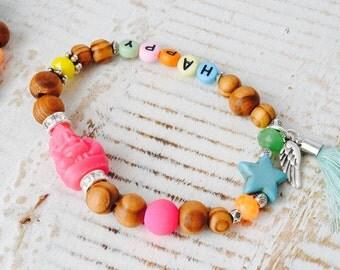 Personalized happy Ganesha bracelet made of olive wood