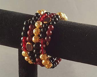 Black,  red, and gold memory wire bracelet