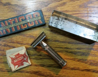 Vintage Old Tin Lithographed Anticor Corn Shaver with 3 pc Razor & Blades with Tin Container