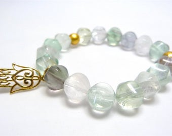 Bracelet made of fluorite with gold-plated Hamsa pendant