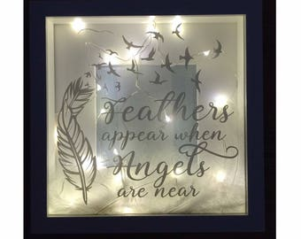Light up box frame - feathers appear when angels are near
