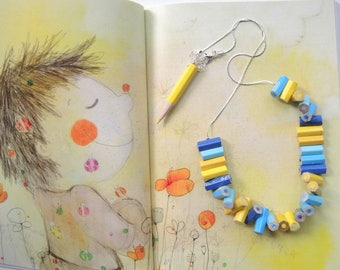 Wooden necklace with blue, blue and yellow colored pencils