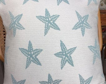 Outdoor treated fabric in a pale blue starfish design
