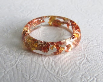 Resin ring. Gilding flakes. Approx. UK Q 3/4 or US 8 1/2