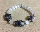 Black/Redline Marble Stone Rectangle and White Cat's Eye Glass Beads with Silver Tone Accents Beaded Stretch Bracelet