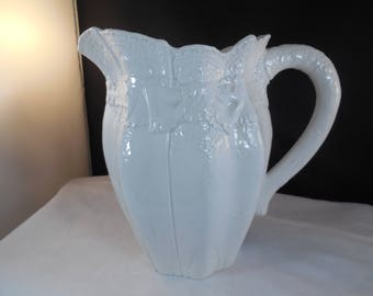 """Ceramic milk pitcher,  the bottom states:  """"Made in Italy 7355""""."""