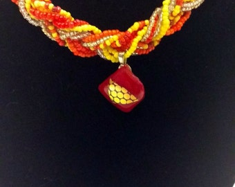 warm color braided necklace with charm