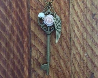 Key and wing necklace
