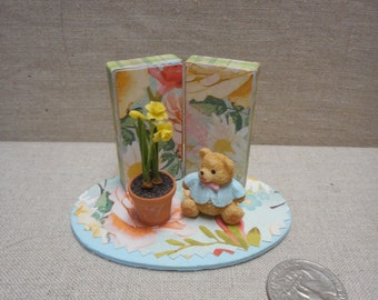 Miniature scene - teddy bear with daffodils