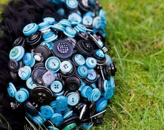 Blue and black button wedding bouquet with feathers