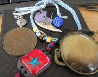 vintage items approx 10 as  shown mostly wearable rings,pendant,keyring,pendants,earrings