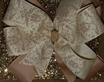 Large triple layer gold bow