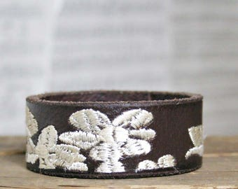 CUSTOM HANDSTAMPED narrow brown leather cuff with stitching by mothercuffer