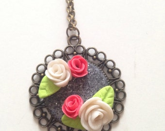 Colliet flowers pink red and white with leaves on a stone effect glittery granite in polymer clay fimo do hand