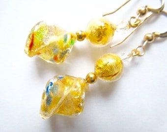 Gold Murano glass earrings with gold filled hooks.