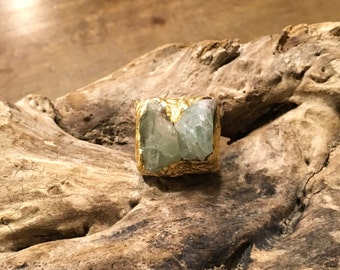 Wooden and aquamarine ring with gold leaf.