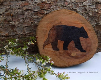 Rustic wood round with a hand burnt pyrography bear design.
