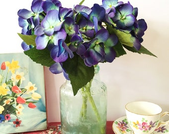 A beautiful Edwardian wide necked green glass bottle   ideal vase  
