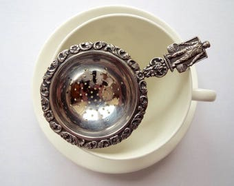 Vintage Tea Strainer. Silverplate looseleaf tea infuser with little man carrying water. Possibly Dutch silver plate. Perfect for a tea party