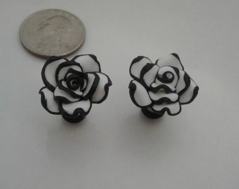 White with black trim acrylic roses ear plugs in 8g, 4g, 2g, 0g