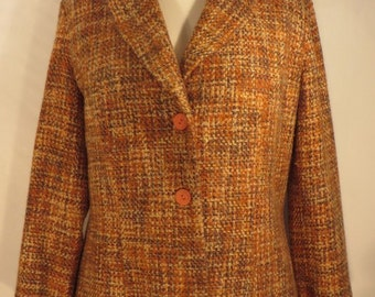 Vintage 1970s lovely brown, orange and buttermilk 100% wool boucle jacket. The body is lined. UK size 16, US 14, EU 44.