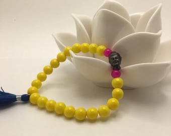 Yellow & Hot Pink Glass Beaded flexible bracelet with a Dark Pewter Buddha Head and Navy Blue Tassel.