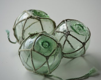 3 Green Vintage Japanese Fishing Floats with netting - 2 with kanji marks