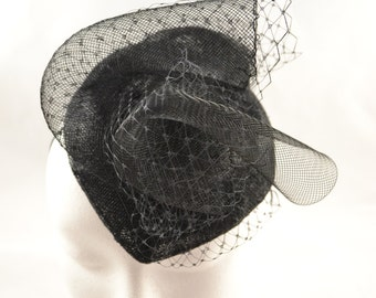 Black teardrop fascinator with crib & veiling