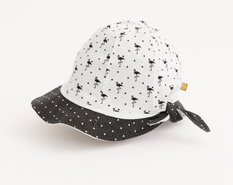 PLAGE - reversible hat for baby - black and white with polka dots and flamingos print