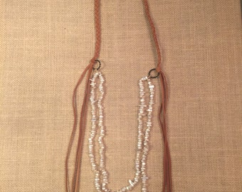 Braided leather necklace with shell beads