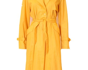 A vintage Ted Lapidus yellow trench rain jacket