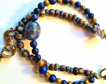 Southwest Denim lapis and Picasso Czech glass beaded handmade double-strand bracelet with kokopelli and moon charms
